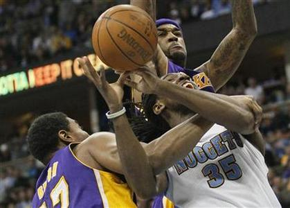 Los Angeles Lakers center Andrew Bynum (L) fouls Denver Nuggets Kenneth Faried (34) as Lakers Jordan Hill (top) defends late in Game 4 of their NBA Western Conference basketball playoffs in Denver May 6, 2012. REUTERS/Rick Wilking