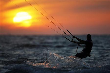 A man kite surfs in the Mediterranean sea in the southern Israeli city of Ashkelon April 26, 2011. REUTERS/Amir Cohen