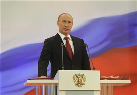 Vladimir Putin is sworn in as the new Russian president during a ceremony at the Kremlin in Moscow, May 7, 2012. REUTERS/Vladimir Rodionov/RIA Novosti/Pool