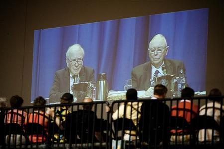 Shareholders watch a Q&A session with Berkshire Hathaway chairman Warren Buffett and vice chairman Charlie Munger during the Berkshire Hathaway Annual shareholders meeting in Omaha, May 5, 2012. REUTERS/Lane Hickenbottom
