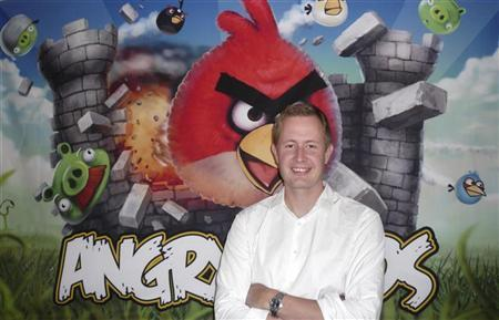 Rovio Chief Executive Mikael Hed stands in front of an Angry Birds poster at his company's offices in Helsinki August 16, 2010. REUTERS/Georgina Prodhan