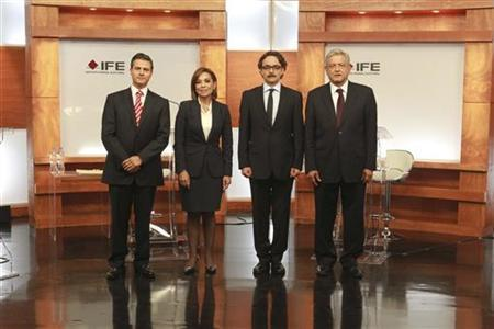 Presidential candidates pose before attending their first televised debate in Mexico City's World Trade Centre in this May 6, 2012 handout released by the Instituto Federal Electoral (IFE). REUTERS/Instituto Federal Electoral/Handout