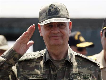Former Turkish Chief of Staff General Ilker Basbug salutes during the EFES-2010 military exercise in Izmir May 26, 2010. The exercise, which takes place between May 6 to May 29, is held annually by the Turkish Army to test the training and support levels of its various units. REUTERS/ Osman Orsal (TURKEY - Tags: MILITARY HEADSHOT)