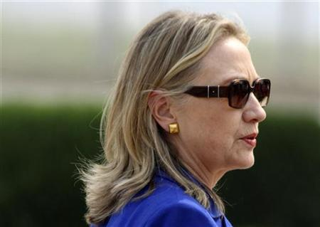 U.S. Secretary of State Hillary Clinton walks past after arriving at the airport in New Delhi May 7, 2012. REUTERS/B Mathur