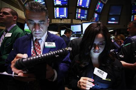 Traders work on the floor of the New York Stock Exchange May 7, 2012. REUTERS/Brendan McDermid