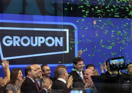 Employees and guests of Groupon ring the opening bell in celebration of the company's IPO at the Nasdaq Market in New York November 4, 2011. REUTERS/Brendan McDermid/Files