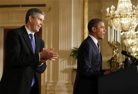 U.S. President Barack Obama talks about providing states flexibility under reauthorization of the No Child Left Behind Act as Secretary of Education Arne Duncan (L) applauds in the East Room of the White House in Washington, February 9, 2012. REUTERS/Larry Downing/Files