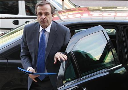 Greek conservative party leader Antonis Samaras arrives at the headquarters of his party in Athens May 7, 2012. REUTERS/John Kolesidis