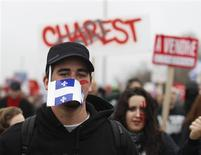 A protester marches during a demonstration against tuition fee hikes in Victoriaville, Quebec, May 4, 2012. REUTERS/Christinne Muschi