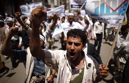 Anti-government protesters shout slogans during a demonstration in Sanaa May 7, 2012. REUTERS/Khaled Abdullah