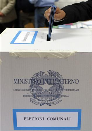 A man casts his ballot at a polling station in Cvitavecchia, 70 km (43 miles) north of Rome, May 6, 2012. REUTERS/Giampiero Sposito