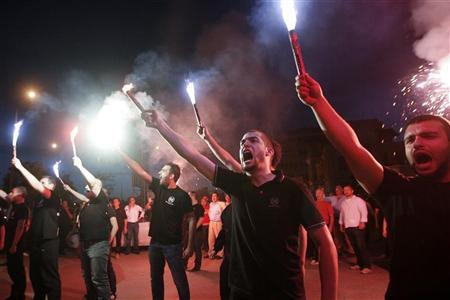 Supporters of the extreme-right Golden Dawn party raise flares as they celebrate polls results in Thessaloniki, northern Greece May 6, 2012. REUTERS/Grigoris Siamidis
