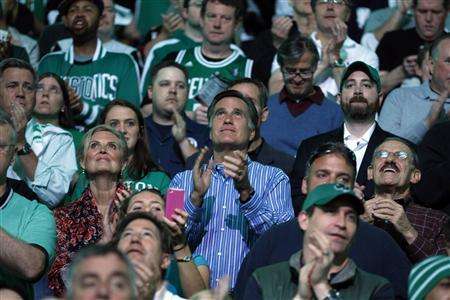 Republican presidential candidate and former Massachusetts Governor Mitt Romney (C), with his wife Ann at his side, applauds before Game 4 of the NBA Eastern Conference playoff basketball series between the Atlanta Hawks and the Boston Celtics in Boston, Massachusetts May 6, 2012. REUTERS/Brian Snyder