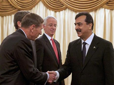Pakistan's Prime Minister Yusuf Raza Gilani (R) shake hands with U.S. CIA Director David Petraeus (L), as U.S. Ambassador to Pakistan Cameron Munter, (C) looks on at prime minister residence in Islamabad October 20, 2011. REUTERS/Mian Khursheed