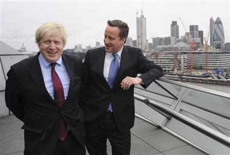Britain's Prime Minister David Cameron (R) and London Mayor Boris Johnson stand on a balcony at City Hall in central London May 5, 2012. REUTERS/Stefan Rousseau/Handout