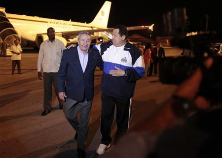 Venezuelan President Hugo Chavez (R) is welcomed by Cuban President Raul Castro at Jose Marti airport in Havana May 1, 2012. REUTERS/Handout/Miraflores Palace