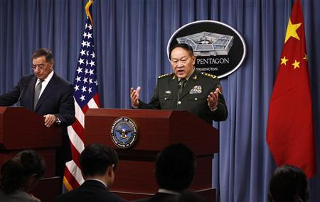 China's Defence Minister Liang Guanglie speaks next to U.S. Secretary of Defense Leon Panetta (L) during a joint news conference following their meeting at the Pentagon in Washington May 7, 2012. REUTERS/Kevin Lamarque