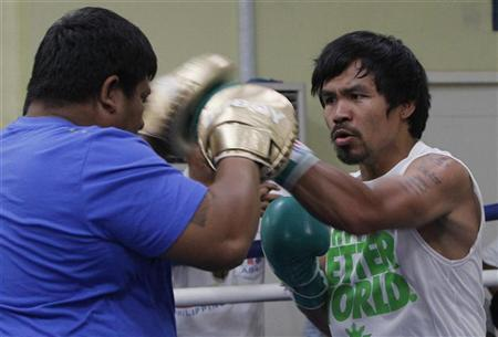 World Boxing Champion and Congressman Manny 'Pacman' Pacquiao starts his training at the gym in Manila April 16, 2012. REUTERS/Romeo Ranoco