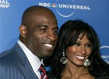 "Former NFL player Deion Sanders and his wife Pilar, stars of the Oxygen Network's"" ""Deion and Pilar: Prime Time Love"", arrive at the NBC Universal Experience as part of upfront week in New York on May 12, 2008. REUTERS/Shannon Stapleton"