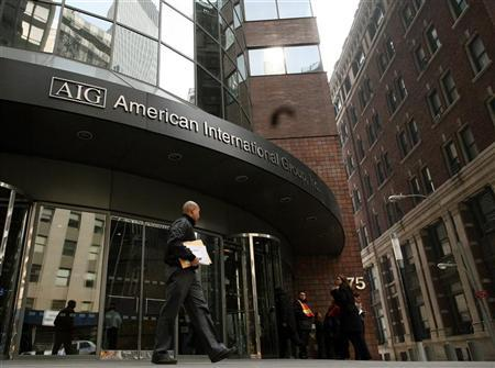 A man walks past the American International Group (AIG) building in New York's financial district. REUTERS/Brendan McDermid