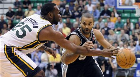 San Antonio Spurs point guard Tony Parker tries to drive past Utah Jazz center Al Jefferson (25) during the first half of their NBA basketball game in Salt Lake City, Utah, May 7, 2012. REUTERS/Eli Lucero