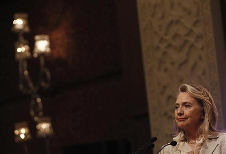U.S. Secretary of State Hillary Clinton stands as India's Foreign Minister S M Krishna (not pictured) speaks during a news conference in Delhi May 8, 2012. REUTERS/Shannon Stapleton