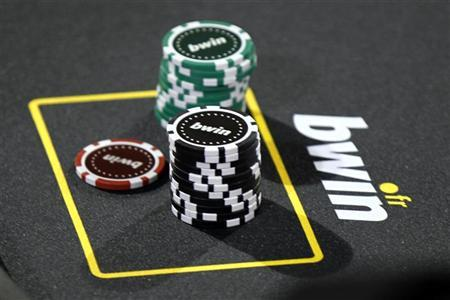 Betting company Bwin Interactive Entertainment AG logo is pictured with chips on a poker table during an event in Paris, December 3, 2010. REUTERS/Charles Platiau
