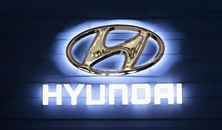 The Hyundai Motor Company logo is seen on a wall at the Qatar International Motor Show in Doha January 27, 2012. REUTERS/Fadi Al-Assaad