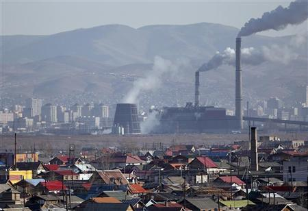 Smoke billows from the chimneys of a coal-burning power plant in Ulan Bator October 14, 2011. REUTERS/Carlos Barria