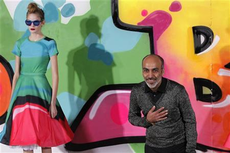 Indian designer Manish Arora appears with a model at the end of his Fall/Winter 2012-2013 women's ready-to-wear fashion show during Paris fashion week March 1, 2012. REUTERS/Stephane Mahe