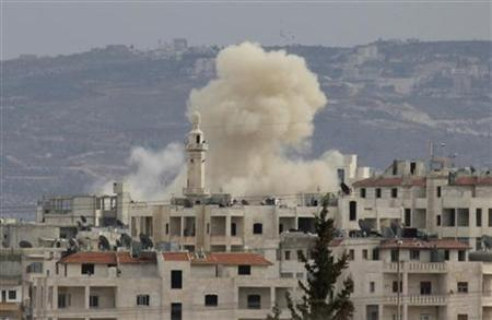 Smoke rises as Idlib city is shelled by government forces March 11, 2012. REUTERS/Stringer