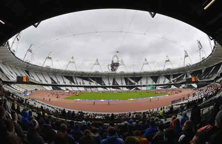 Athletes compete in a women's 400m hurdles heat at the BUCS Outdoor Athletics Championships at the Olympic Stadium in London May 4, 2012. REUTERS/Toby Melville