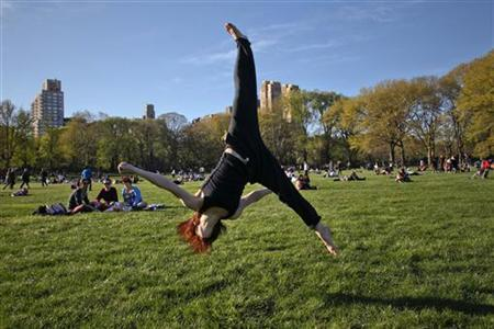 A woman practices aerobic moves in New York's Central Park on April 8, 2012. REUTERS/Eduardo Munoz/Files