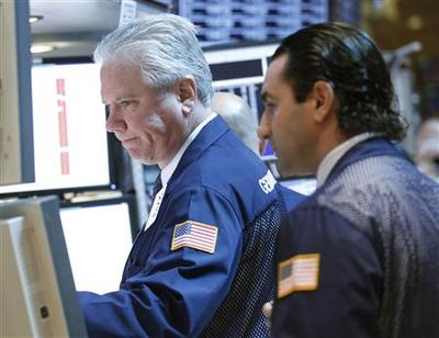 Wall Street falls on Europe, but late buying trims...