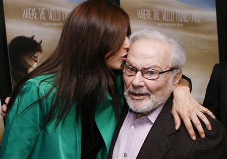 Actor Catherine Keener kisses author Maurice Sendak (R) beore the premiere of the film ''Where The Wild Things Are'' in New York in this file photo taken October 13, 2009. Sendak has died at the age of 83 according to The New York Times. Sendak died in Danbury, Connecticut, from complications from a recent stroke, the Times was told by Sendak's long-time editor, Michael di Capua. REUTERS/Lucas Jackson/Files
