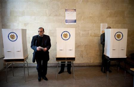 A man holds his ballot paper at a polling station during a parliamentary election in Yerevan May 6, 2012. REUTERS/Nazik Apmenakian