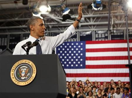 U.S. President Barack Obama waves before he speaks to students and parents about the rising costs of education at Washington-Lee High School in Arlington, Virginia May 4, 2012. REUTERS/Larry Downing