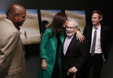 Actor Catherine Keener kisses author Maurice Sendak as director Spike Jonze (R) and actor Forest Whitaker (L) look on before the premiere of the film 'Where The Wild Things Are' in New York October 13, 2009. REUTERS/Lucas Jackson/Files