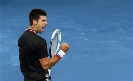Novak Djokovic of Serbia celebrates winning a point against Daniel Gimeno-Traver of Spain during their men's singles match at the Madrid Open tennis tournament May 8, 2012. REUTERS/Susana Vera