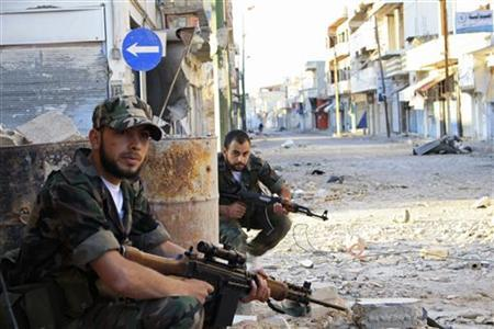 Free Syrian Army fighters patrol a street in Qusair town near Homs city, northern Syria May 5, 2012. REUTERS/Stringer