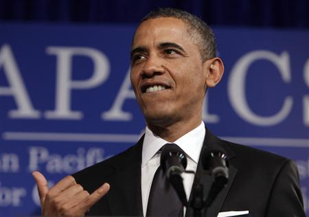 U.S. President Barack Obama gestures shaka at the Asian Pacific American Institute for Congressional Studies (APAICS) 18th annual gala dinner in Washington May 8, 2012. REUTERS/Yuri Gripas