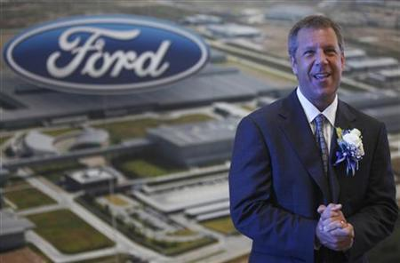Joe Hinrichs, president of Ford Asia Pacific and Africa, poses for photographers before a news conference at the new Ford Thailand manufacturing plant in Rayong province, East of Bangkok May 3, 2012. REUTERS/Chaiwat Subprasom