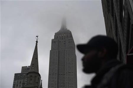 Clouds cover the Empire State Building in New York, May 3, 2012. REUTERS/Keith Bedford