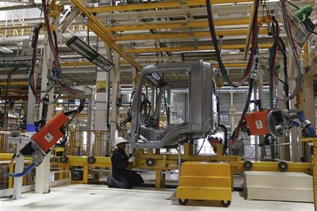 An employee works on the body of a BharatBenz truck inside Daimler's new factory in Oragadam, in the Kancheepuram district of Tamil Nadu April 18, 2012. REUTERS/Babu