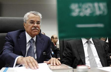 File photo of Saudi Arabia's Oil Minister al-Naimi looks at documents at the beginning of an OPEC meeting in Vienna. REUTERS/Heinz-Peter Bader