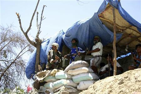 Armed pro-government tribesmen stand guard at a checkpoint they man on the way to the southern Yemeni city of Lawdar, where clashes between army forces and al Qaeda-linked militants have taken place for several weeks, in this May 5, 2012 file photo. REUTERS/Stringer/Files