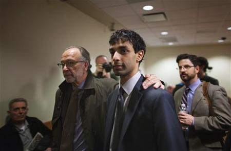 Dharun Ravi (C), a former Rutgers University student charged with bias intimidation, departs the courtroom with lead defense attorney Steven Altman at the Superior Court of New Jersey in Middlesex County, New Brunswick, New Jersey March 15, 2012. REUTERS/Lucas Jackson/Files