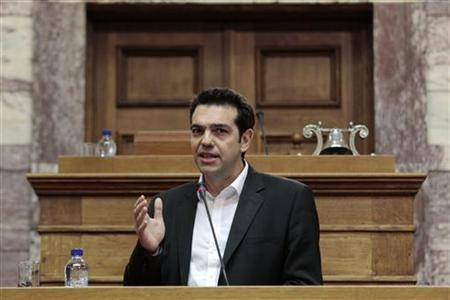 Leader of the Left Coalition party Alexis Tsipras addresses his parliamentarians in Athens May 9, 2012. REUTERS/Yorgos Karahalis