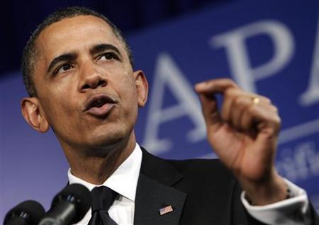 U.S. President Barack Obama gestures during the Asian Pacific American Institute for Congressional Studies (APAICS) 18th annual gala dinner in Washington May 8, 2012. REUTERS/Yuri Gripas