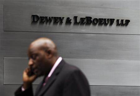 A man talks on his phone as he walks past the building housing the law firm Dewey & LeBoeuf LLP in New York, May 8, 2012. REUTERS/Lucas Jackson
